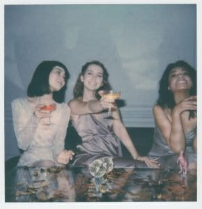 instant-photo-of-three-women-drinking-3550237